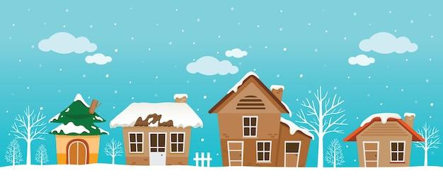 Panorama di case, neve che cade, tetto innevato
