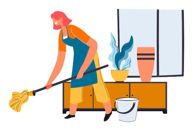 La casalinga lava il pavimento con un panno umido e acqua