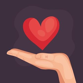 Cuore della holding della mano umana