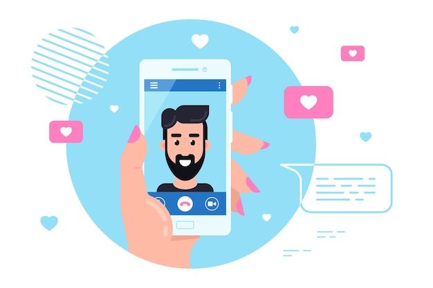 Mano umana che tiene smartphone con personaggio maschile sullo schermo. videochiamata, chat video online