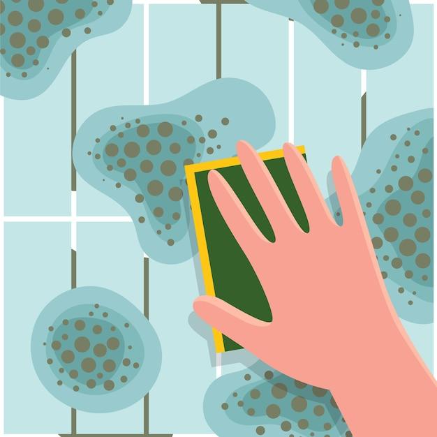 La mano umana lava la muffa dalle piastrelle di ceramica.