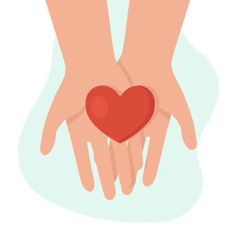Mani umane che tengono un cuore.