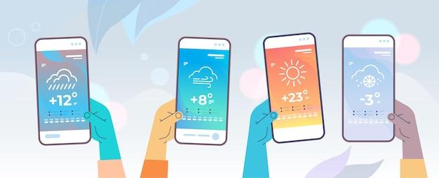 Mani umane che tengono smartphone con previsioni del tempo per app mobile di temperatura giornaliera e illustrazione vettoriale orizzontale di concetto di meteorologia