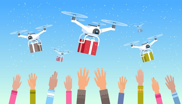 Mani umane sollevate droni che consegnano regali presenti scatole cielo trasporto spedizione posta aerea consegna espressa concetto zione