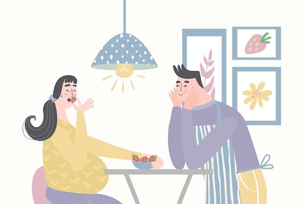 Marito che alimenta la moglie incinta. dieta sana per la donna incinta.