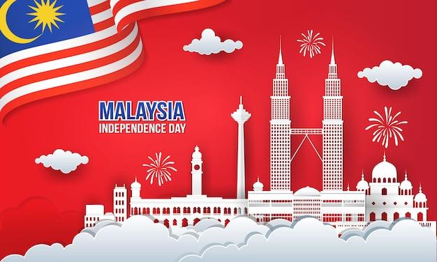 Illustrazione di 63 anni festa dell'indipendenza della malesia con skyline della città, bandiera della malesia e fuochi d'artificio in carta tagliata e stile artigianale digitale