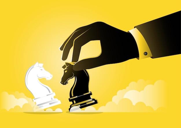 Un'illustrazione di una mano di uomo d'affari che tiene in mano un pezzo di cavaliere degli scacchi nero, concetto strategico