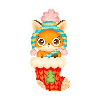 Illustrazione della volpe di natale simpatico cartone animato in cappello con la caramella in calzino rosso di natale