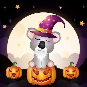 L'illustrazione di un koala della strega di halloween del fumetto sveglio sta sulla parte anteriore della zucca della luna