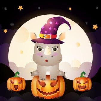 Illustrazione di un rinoceronte strega halloween simpatico cartone animato stare sulla parte anteriore della zucca la luna