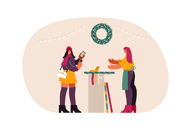 Illustrazione del cliente femminile che comunica con il venditore vicino al bancone e l'acquisto di smartphone durante la vendita di natale nel negozio moderno