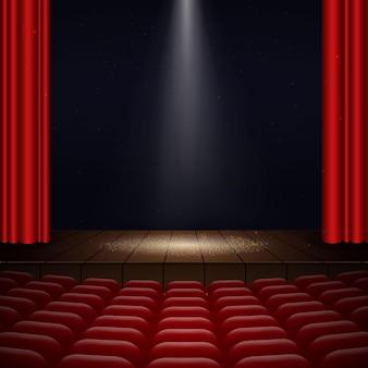 Illustrazione dell'interno di un cinema con tende rosse, file di sedili, scena in legno