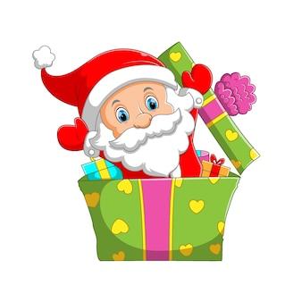 L'illustrazione del mini babbo natale con il cappello di natale che spunta dalla graziosa grande scatola di regali