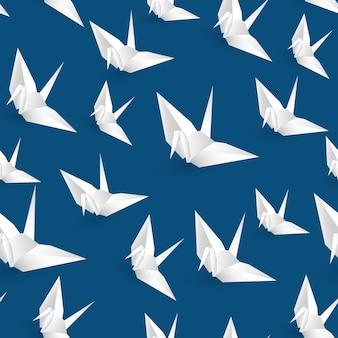 Illustrazione dell'uccello senza cuciture di origami del libro bianco su fondo blu.