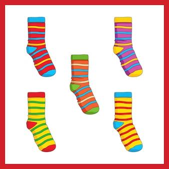 Illustrazione di una serie di simpatici calzini colorati. calzini di consapevolezza per la giornata dell'autismo.