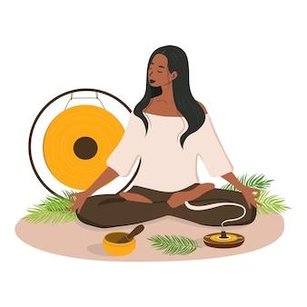 Un'illustrazione di una donna che fa yoga accanto all'incenso in piedi che canta una ciotola e un gong