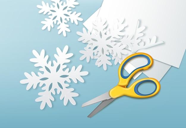 Illustrazione di forbici gialle e fiocchi di neve di carta tagliata con fogli di carta