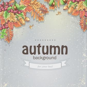 Immagine di sfondo autunnale con foglie di acero, quercia, castagno, bacche di sorbo e ghiande