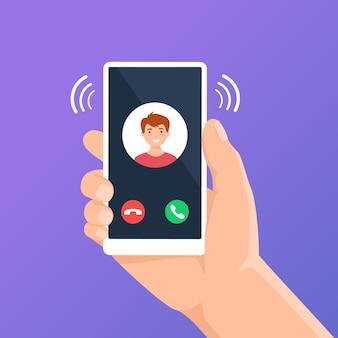 Chiamata in arrivo sullo schermo del telefono mano che tiene lo smartphone con il concetto di visualizzazione dell'interfaccia dell'app di chiamata