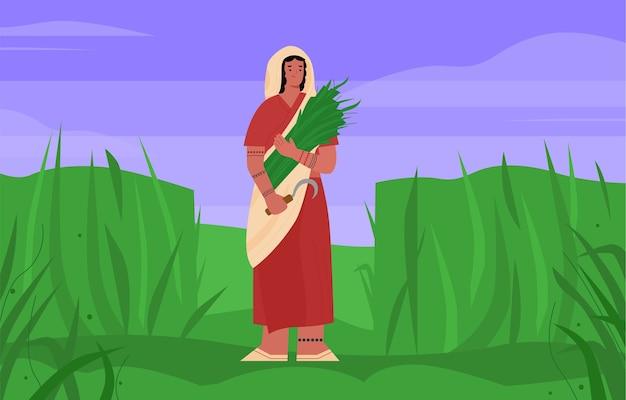 Donna indiana contadina in sari con una falce in mano