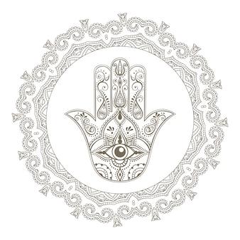 Hamsa indiano disegnato a mano con tutto l'occhio vedente nella cornice di mandala. amuleto arabo ed ebraico.