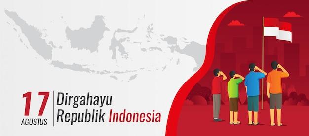 Bandiera di festa dell'indipendenza dell'indonesia con i bambini di saluto