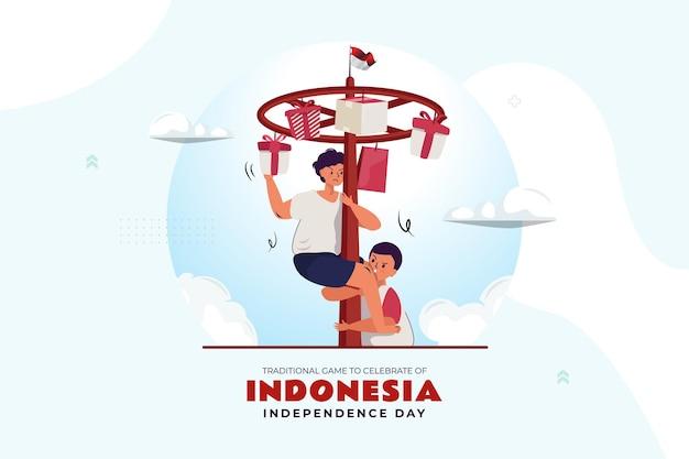 Gioco tradizionale indonesiano del palo scivoloso per celebrare il giorno dell'indipendenza