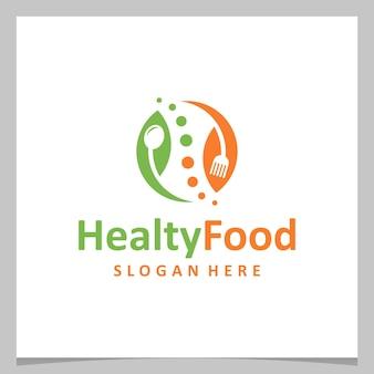 Design del logo di ispirazione cibo sano con posate e foglie. vettore premium