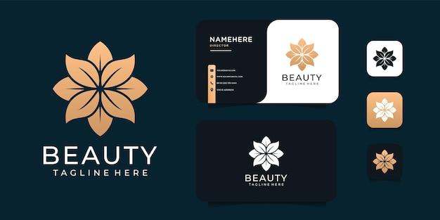 Design del logo fiore d'oro di bellezza ispiratrice