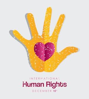Diritti umani internazionali e mano grunge con disegno del cuore, tema 10 dicembre.