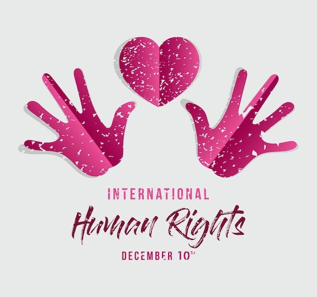 Diritti umani internazionali e mani rosa grunge con disegno a cuore, tema 10 dicembre.