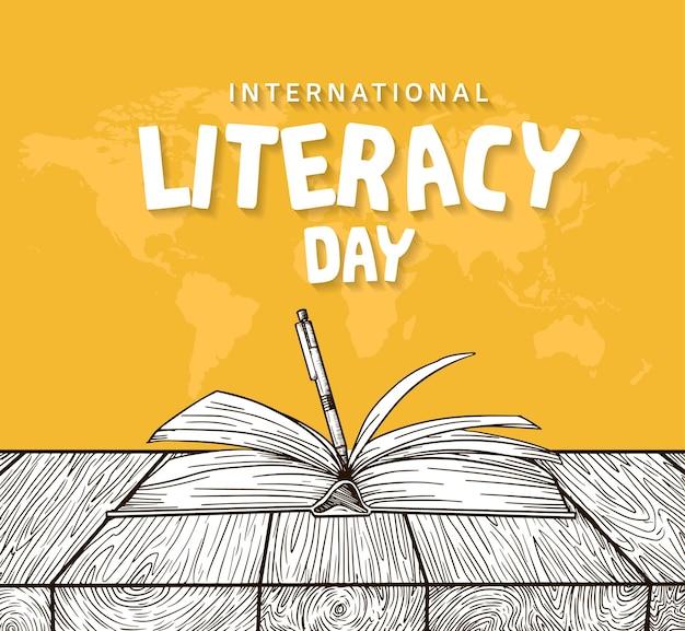 Giornata internazionale dell'alfabetizzazione con libro aperto e penna isolati su sfondo giallo
