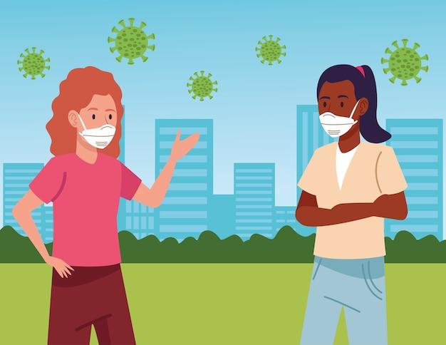 Ragazze interrazziali che indossano maschere mediche sulla città