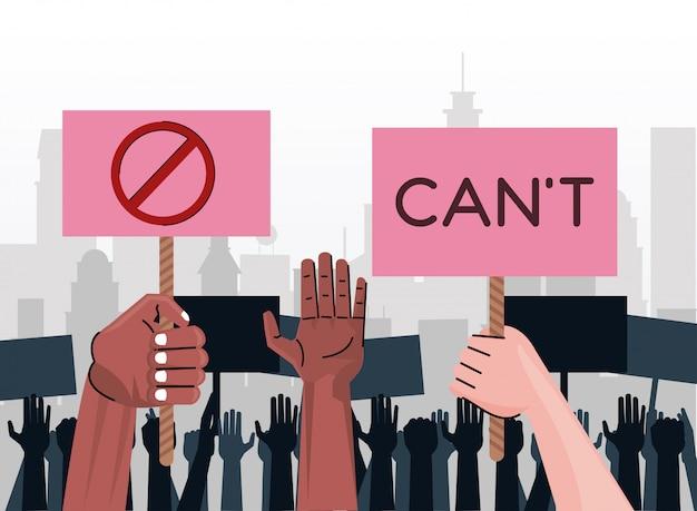 Mani di persone interrazziali che protestano contro cartelli di sollevamento con la parola cant e il simbolo di arresto sulla città