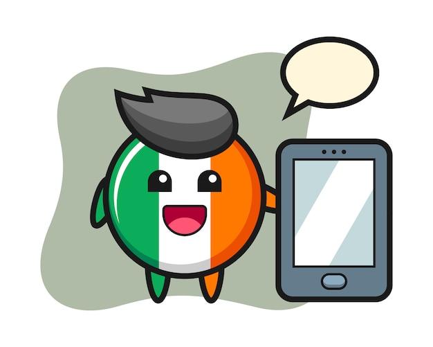 Fumetto dell'illustrazione del distintivo della bandiera dell'irlanda che tiene uno smartphone