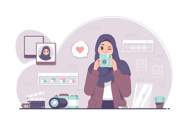 Fotocamera islamica della holding del carattere della ragazza del hijab di fotografia