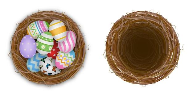 Nido vuoto isolato e nido con l'illustrazione delle uova di pasqua