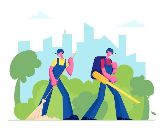 Bidelli maschio e personaggi pulitori di strada spazzare prato e soffiando fuori foglie colorate cadute nel fondo del paesaggio del parco cittadino.