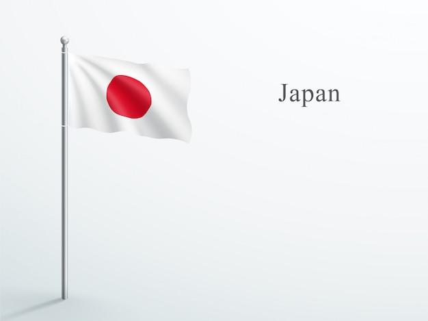 Elemento 3d di bandiera del giappone che ondeggia sul pennone in acciaio