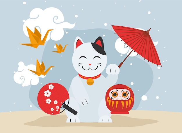 Gatto giapponese con bambola daruma