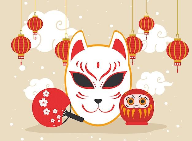 Bambola giapponese daruma e gatto