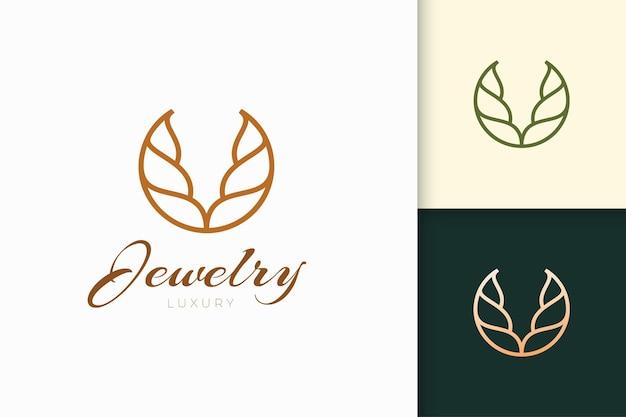 Logo di gioielli in forma elegante e di lusso per la bellezza e la moda