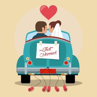 Coppia di sposi in auto d'amore