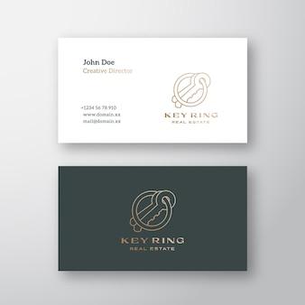 Portachiavi immobiliare astratto contemporaneo minimal logo e modello di biglietto da visita delineato chiavi co...
