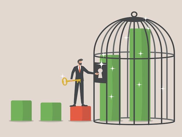 Chiavi per la crescita economica, l'uomo d'affari porta una chiave per aprire un grafico ascendente bloccato da una gabbia