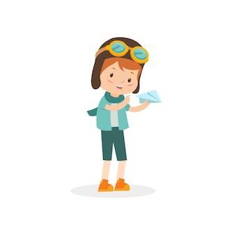 Un bambino che gioca con la carta dell'aeroplano