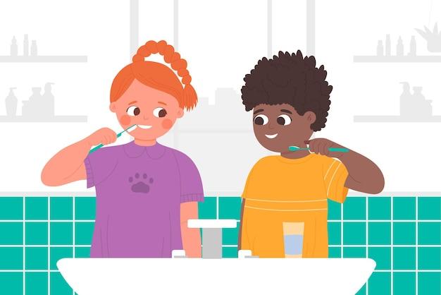 Bambini che si lavano i denti nel bagno di casa con il lavandino