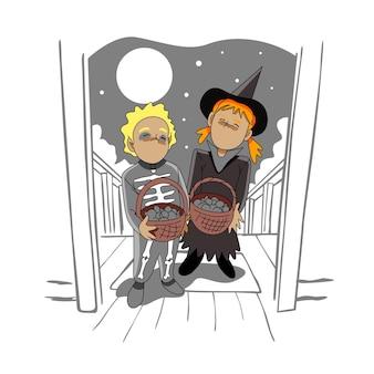 Bambini che fanno dolcetto o scherzetto la notte di halloween
