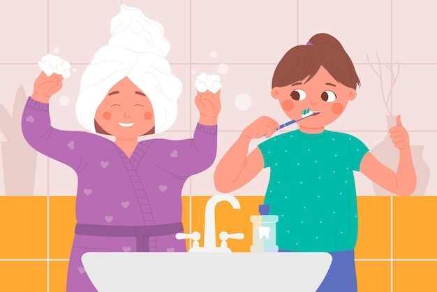 I bambini giocano nel bagno di casa i bambini si lavano i denti giocando insieme durante la routine igienica hygiene