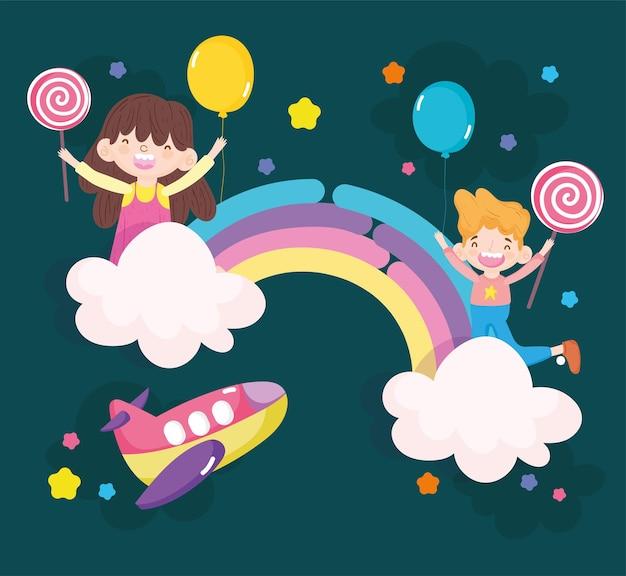 Bambini che giocano sull'arcobaleno